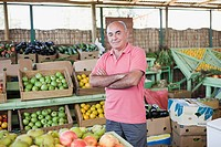 Market trader at fruit and vegetable stall