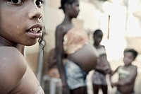 Child with pregnant woman in background, Bahia, Brazil