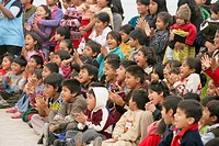 Audience of children applauding, Lima, Peru
