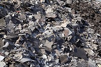 Pile of discarded asphalt roofing shingles in a recycling yard, Laval, Quebec, Canada