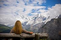 Woman comtemplating Monch mountain  Murren  Switzerland