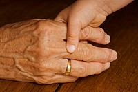 Stock photo of a child holding her grandmas hand