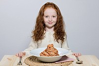 Girl with big bowl of spaghetti bolognese (thumbnail)