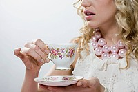 Woman with tea (thumbnail)