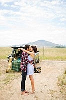 Young couple kissing outdoors (thumbnail)
