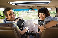 Couple in vehicle with map