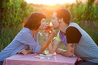 Couple drinking wine in a field