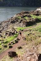 Young Woman Jogging Along Trail, Rear View