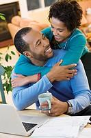 African American husband hugging wife