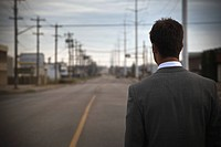 Businessman walking down street alone
