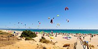 Kitesurfing along the beach of Punta Paloma, Cadiz, Spain