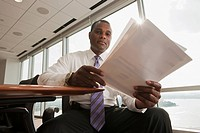 African American businessman reviewing paperwork
