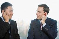 Businessmen talking on cell phones