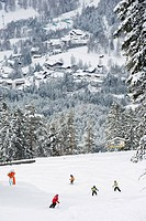 Skiers on piste above Seefeld village, Seefeld, the Tyrol, Austria, Europe