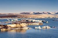 Icebergs in Jokulsarlon glacial lagoon, Breidamerkurjokull Vatnajokull glacier in the distance, East Iceland, Iceland, Polar Regions