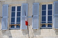 Shuttered windows and French flag, La Flotte, Ile de Re, Charente_Maritime, France, Europe