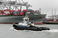 tugboats of the harbour service assist vessels going in and out the harbour of rotterdam