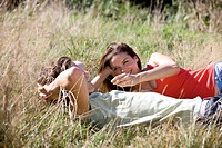 A young couple lying on the grass