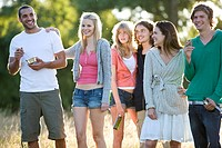 A group of young friends standing in a field (thumbnail)