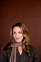 Portrait of a mid adult woman wearing an autumnal scarf and jacket