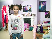 Young Girl standing hands in pocket in bedroom