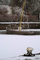 A festively decorated boat frozen in the ice at Coolnahay Harbour, County Westmeath, Ireland, during the Christmas season