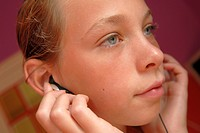 Close_up of a girl listening to music