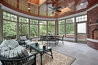 Bluestone porch with brick fireplace and skylights