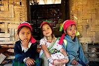 A trio of young Longneck girls outside a hut  Approximately 300 Burmese refugees in Thailand are members of the indigenous group known as the Longneck...