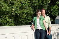 Smiling couple standing on bridge, Assiniboine Park, Winnipeg, Canada