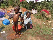 Malnourished child washed by his mother at an MSF feeding centre in Angola  Feeding centres and other humanitarian aid were organised in Angola after ...