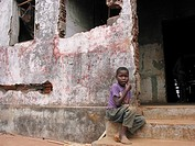 A boy sits by a destroyed buildingin Angola  Feeding centres and other humanitarian aid were organised in Angola after widescale malnutrition during a...