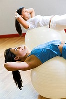 health club: woman doing stretching and aerobics