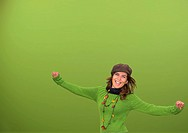 Young happy woman in a green background
