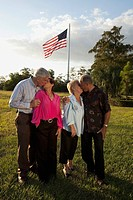 fort lauderdale, florida, united states of america, two couples kissing with the america flag flying overhead