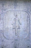 Restroom Sign on Cement Wall