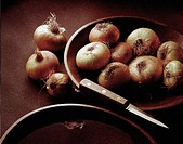 Bowl Of Onions With Knife
