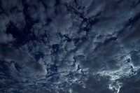 Textured Clouds In A Dark Sky