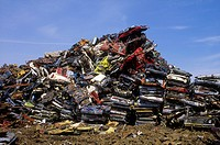 Flattened Cars Piled Up In The Junkyard