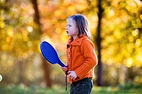 Girl playing paddle ball