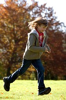 Girl running in a park