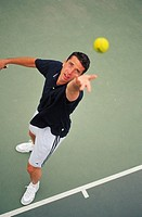 High angle view of a man serving at a tennis match