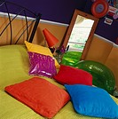 Close_up of assorted cushions on a bed