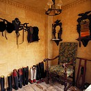 View of assorted boots and riding gear displayed on a wall