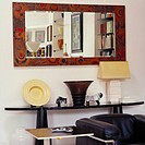 View of a mirror above a mantle in a living room