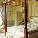 Close_up of a canopied four poster bed
