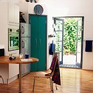 A modern kitchen with a door opening into the garden