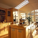 View of a modern wooden kitchen with a skylight