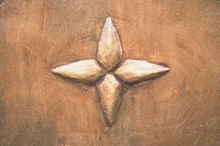Close_up of a star embossed on a wall