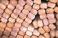 Close_up of a pile of wooden logs